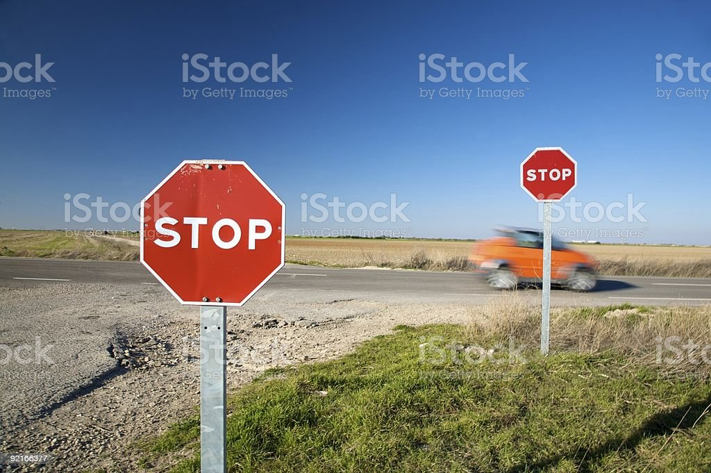 speed car through stop traffic signs royalty-free stock photo