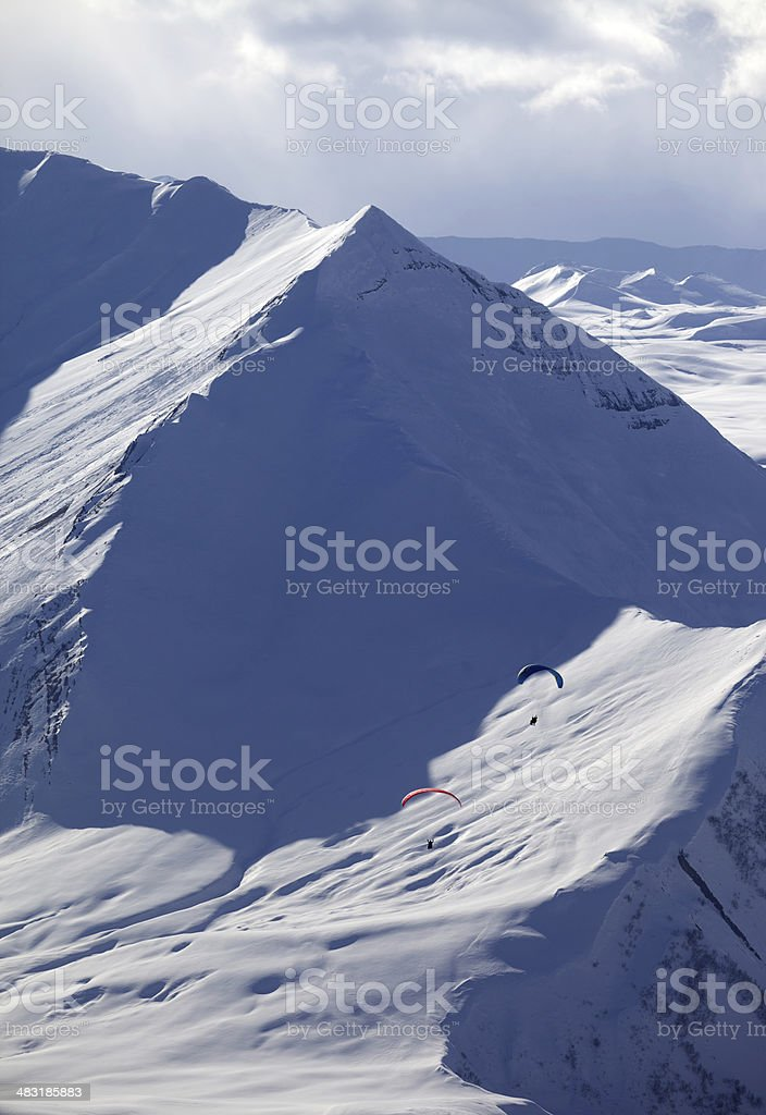 Speed flying in snowy mountains royalty-free stock photo