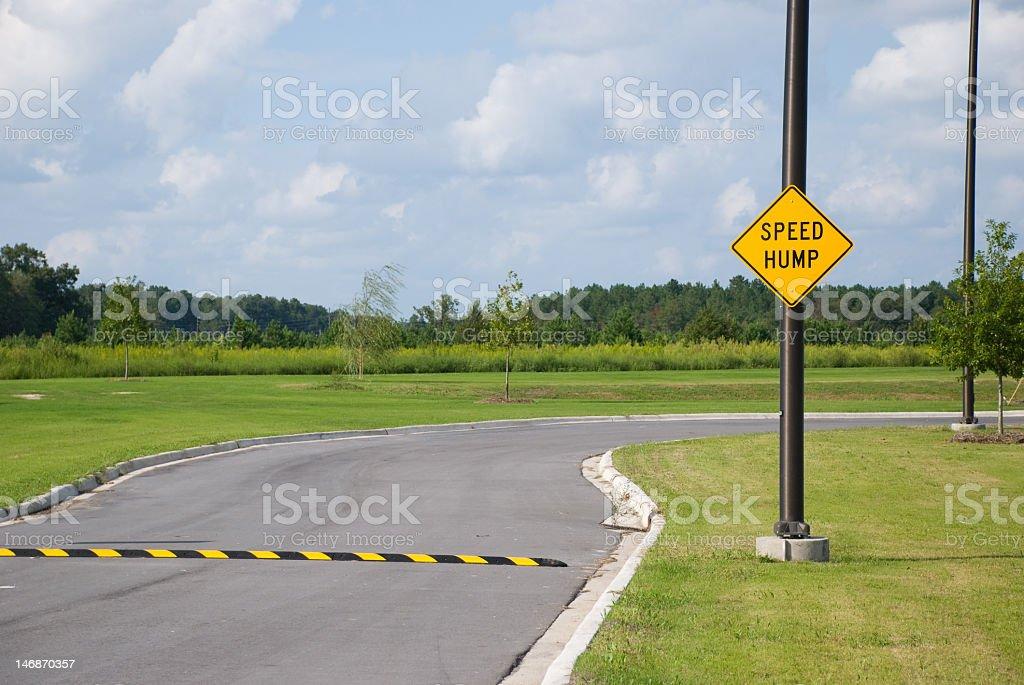 Speed hump in neighborhood street stock photo