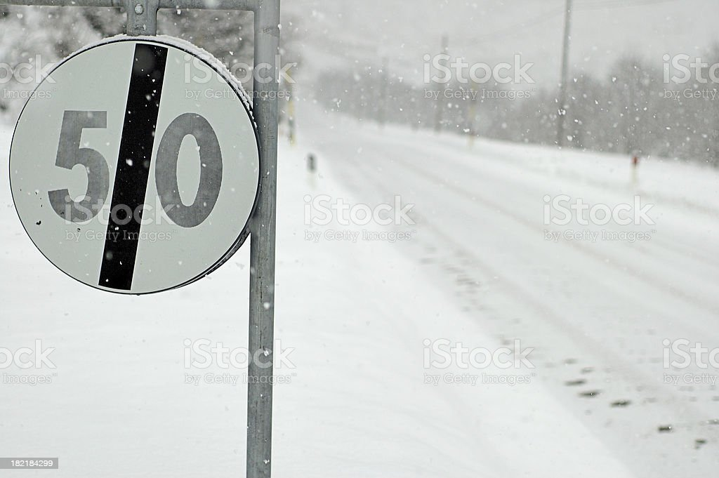Speed limit sign in the snow royalty-free stock photo