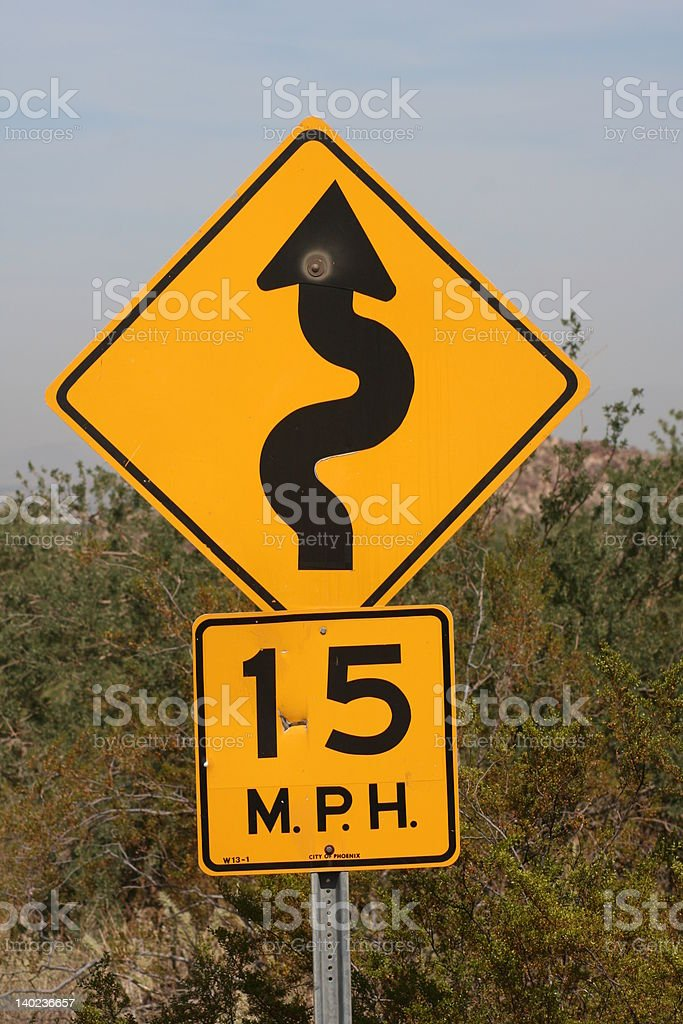 Speed limit sign on a desert road royalty-free stock photo