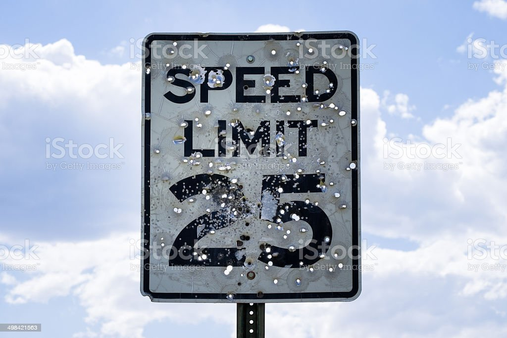 Speed Limit Sign Shot Up with Bullet Holes stock photo