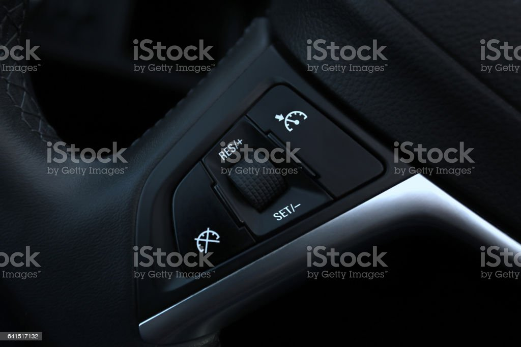 Speed limitation and cruise control buttons on Car stock photo