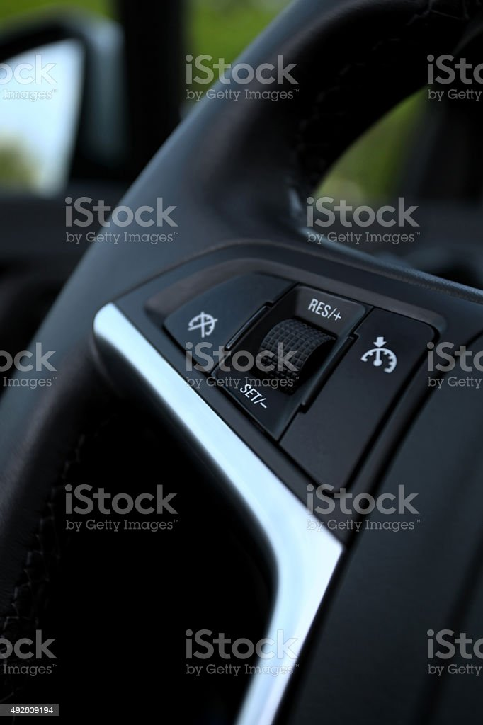 speed limitation on a steering wheel in modern car stock photo