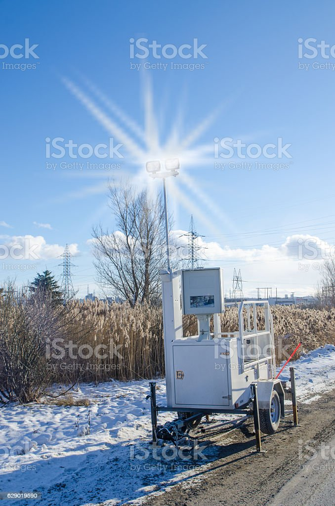 Speed mobile photo radar flashing on side of the road stock photo