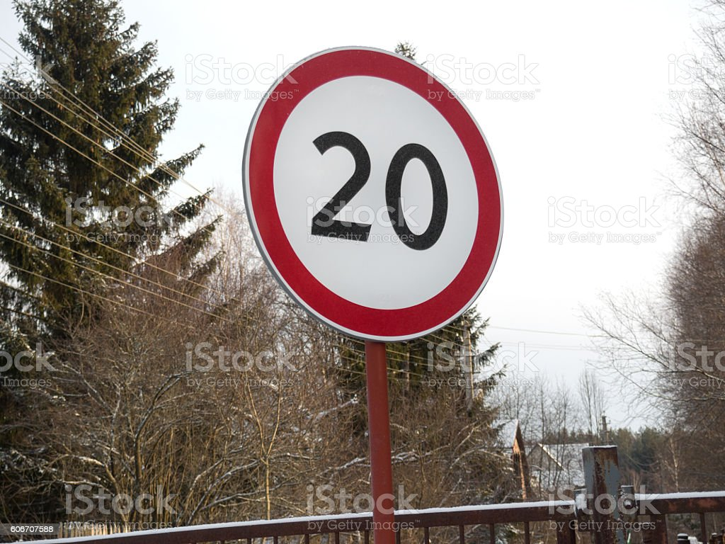 speed restriction road sign stock photo