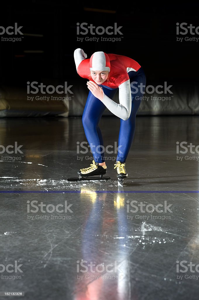 Speed skater at the starting line stock photo