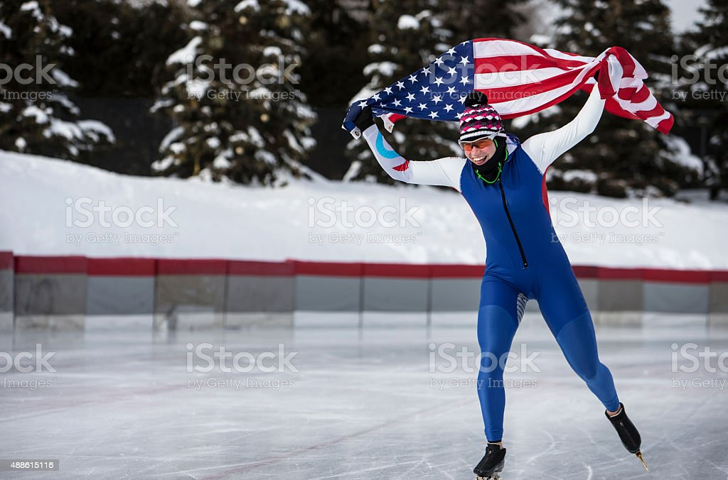 Speed Skater Carrying The American Flag During Victory Lap. stock photo