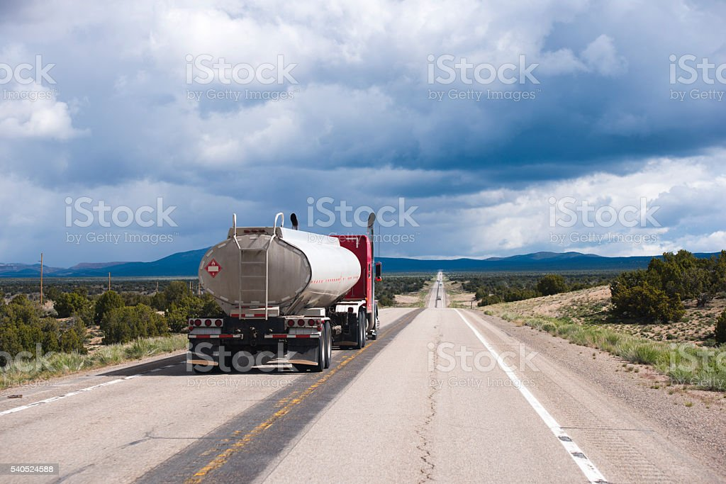 Speed up semi truck rig with tank trailer in Nevada stock photo