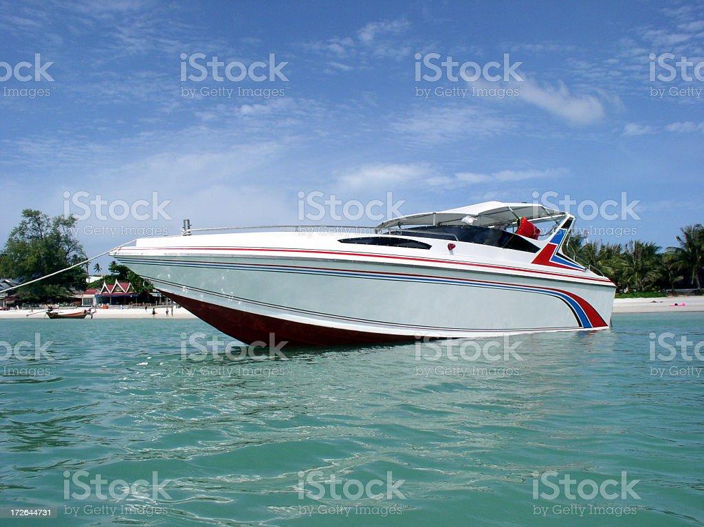 Speedboat anchored near beach in Thailand stock photo