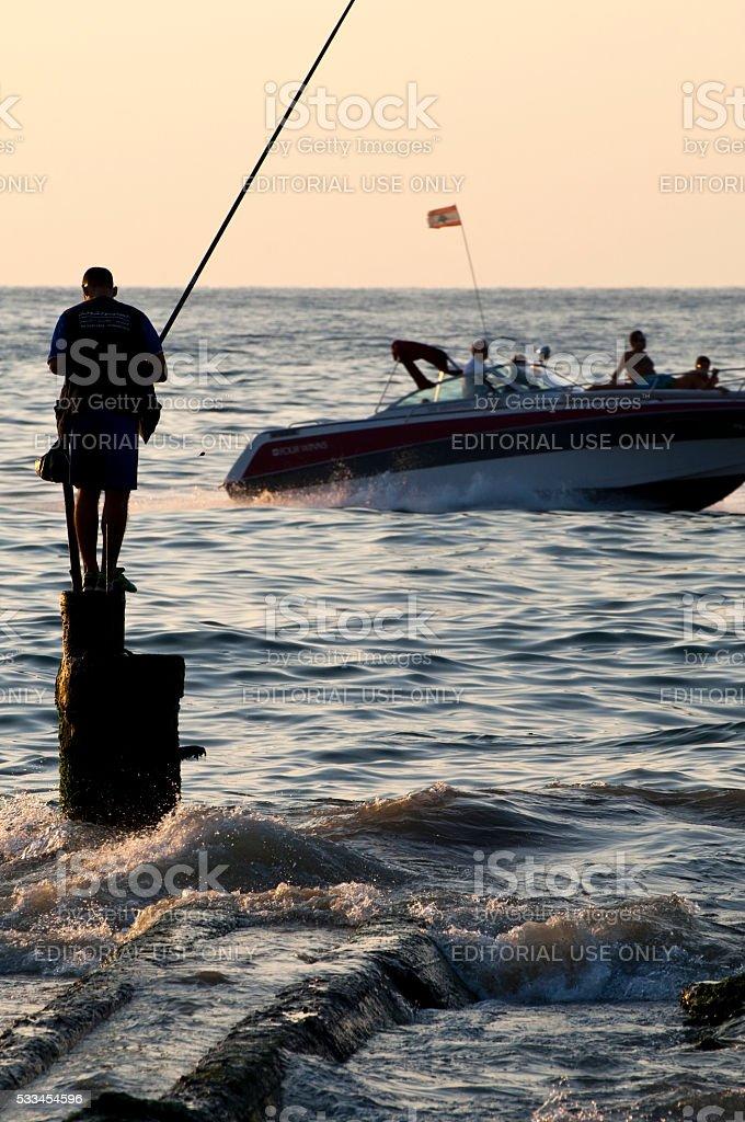 Speedboat and fisherman in Beirut, Lebanon stock photo