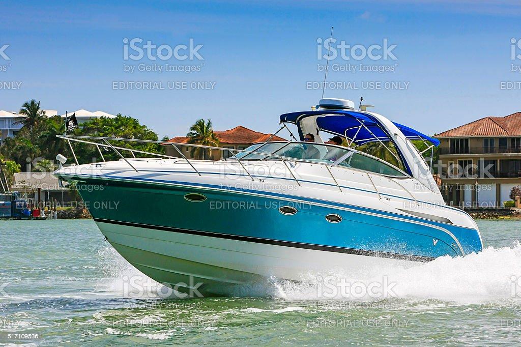 Speedboat at full throttle in Marco Bay near Naples, Florida stock photo
