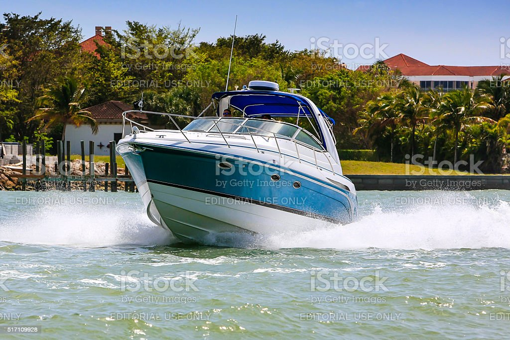 Speedboat at full throttle in Marco Bay near Naples, Florida stock photo