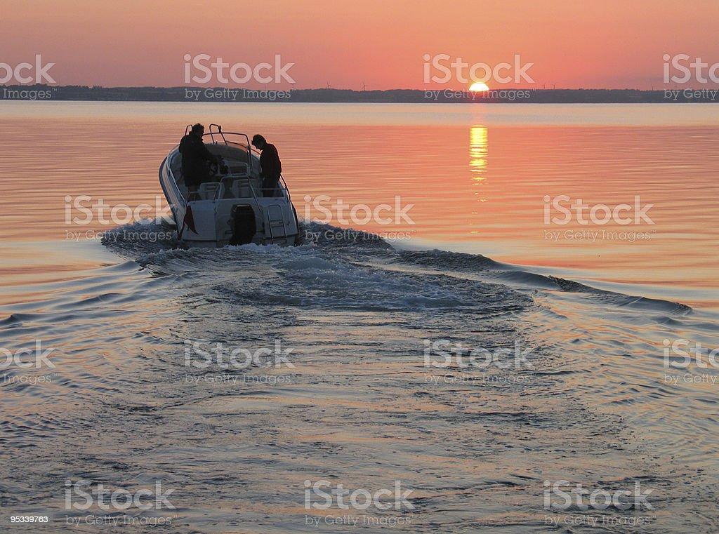 Speedboat in sunset stock photo