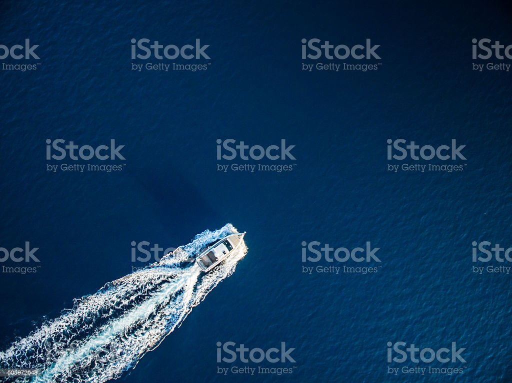 Speedboat racing along the open sea stock photo