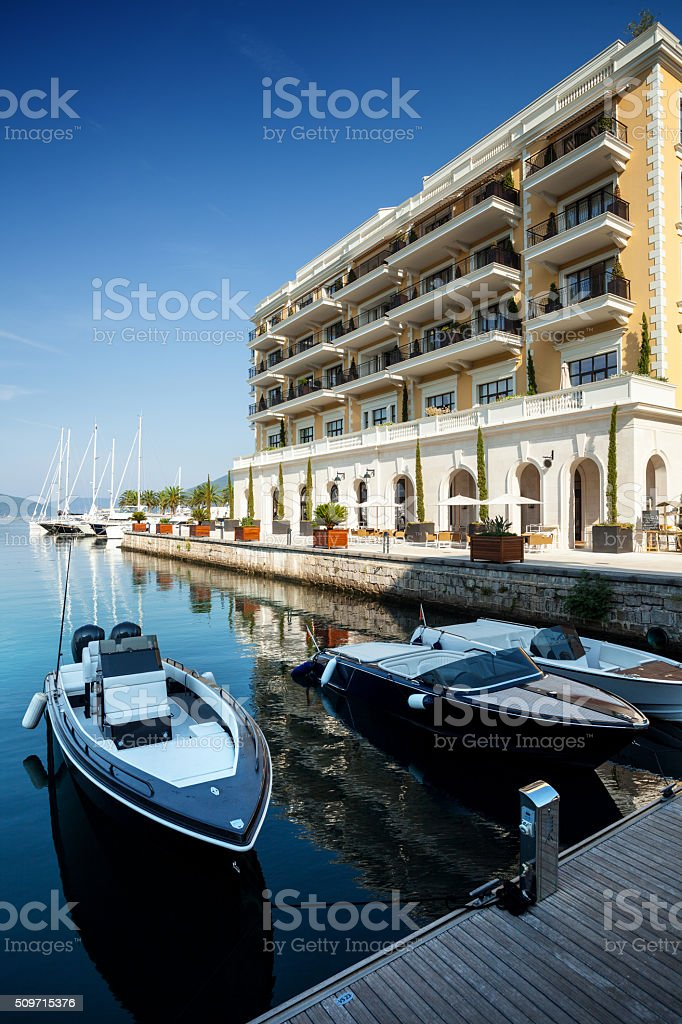 Speedboats at the pier of luxury hotel stock photo