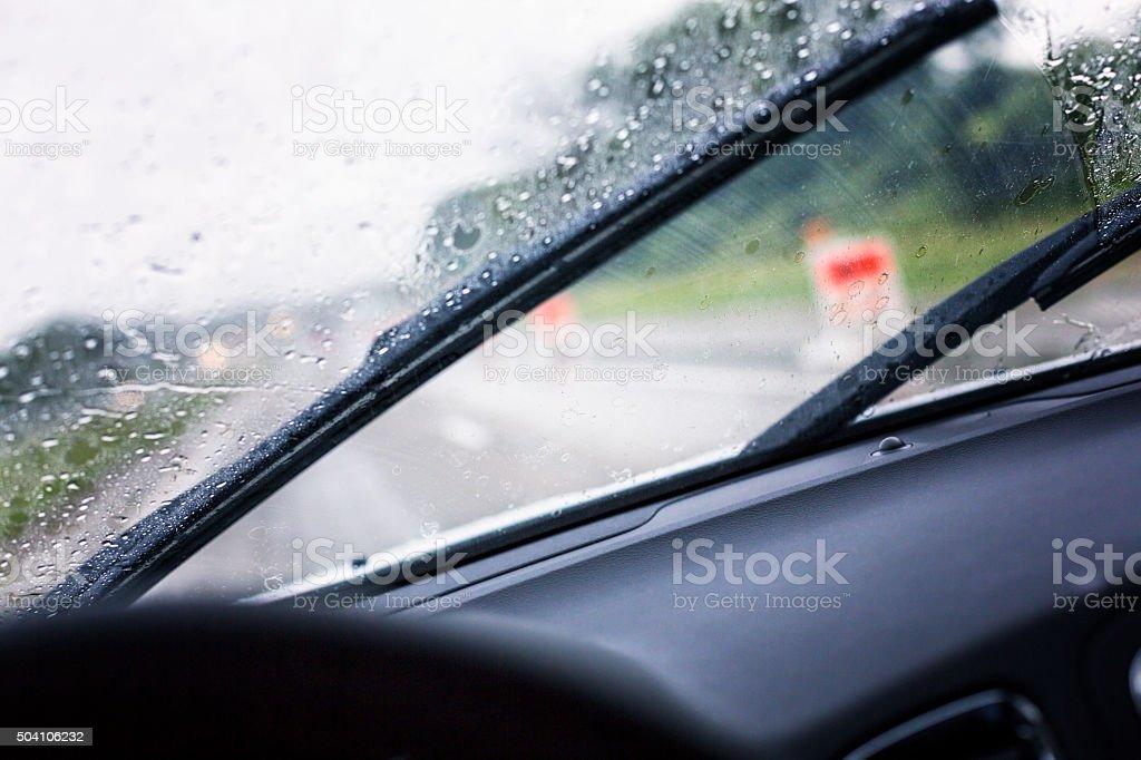 Speeding Car Windshield Wiper Clearing Splashing Rain Storm Water stock photo