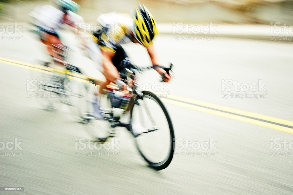 Speeding cyclists with abstract blur stock photo