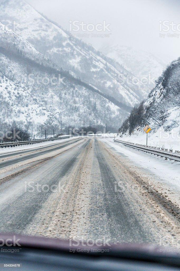 Speeding Downhill On Slushy Slippery Winter Utah Highway stock photo
