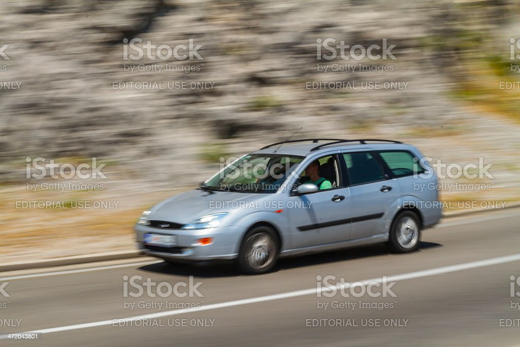 Speeding Ford Focus on Montenegro interurban road royalty-free stock photo