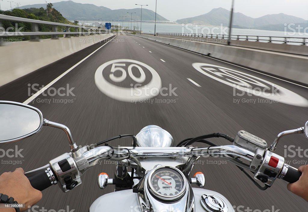 Speeding Motorbike stock photo