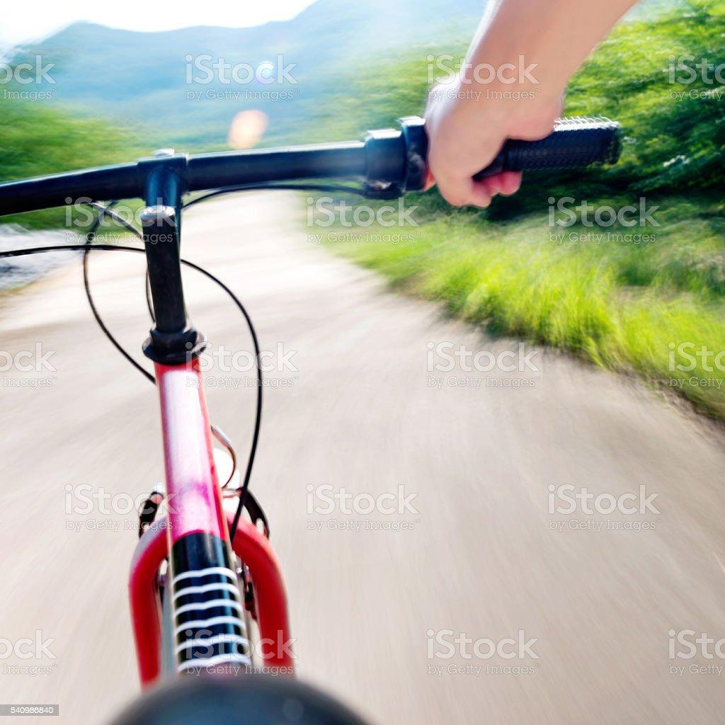 Speeding on mountain bike stock photo