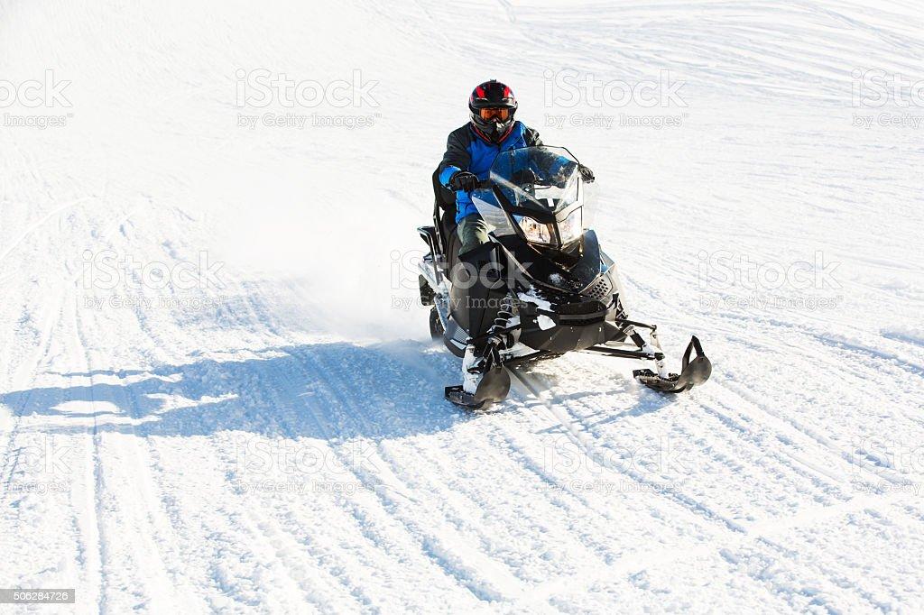 Speeding on snowmobile stock photo
