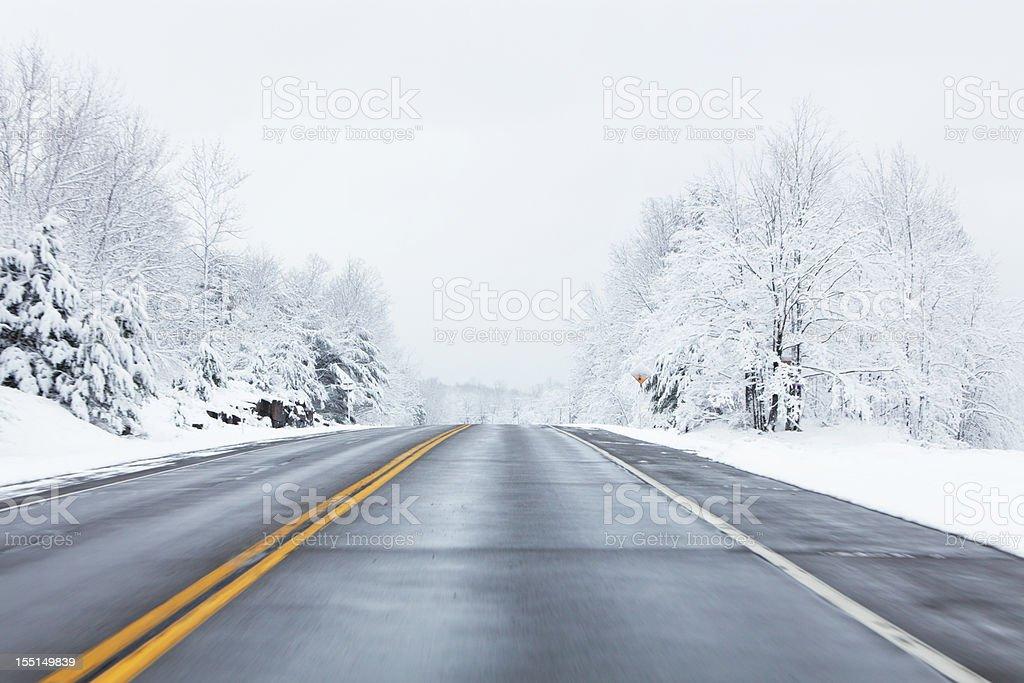 Speeding on Winter Highway stock photo