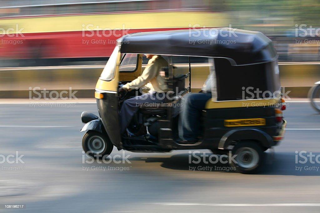 Speeding rickshaw stock photo