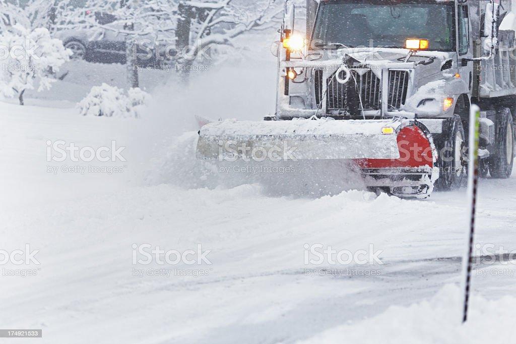 Speeding Snowplow Clearing Blizzard Snow stock photo