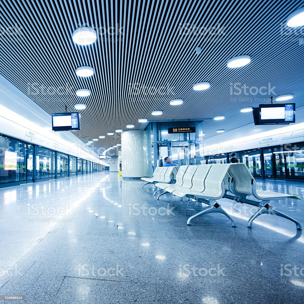 speeding subway with iron seats stock photo