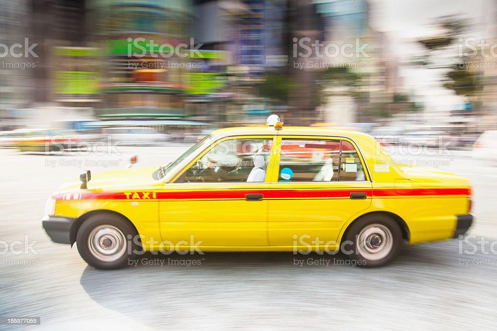 Speeding Taxi in Tokyo City royalty-free stock photo