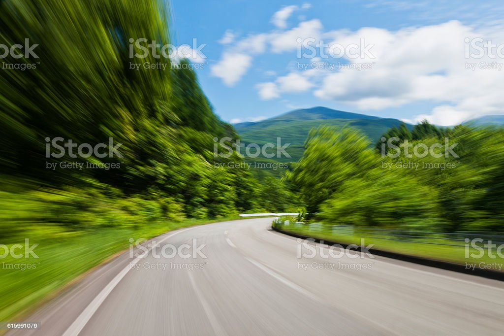 Speeding Through Forest Road stock photo