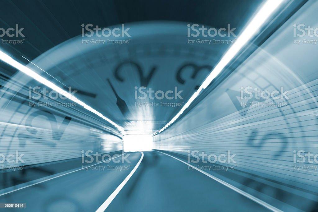 Speeding Through the Tunnel with Clock stock photo