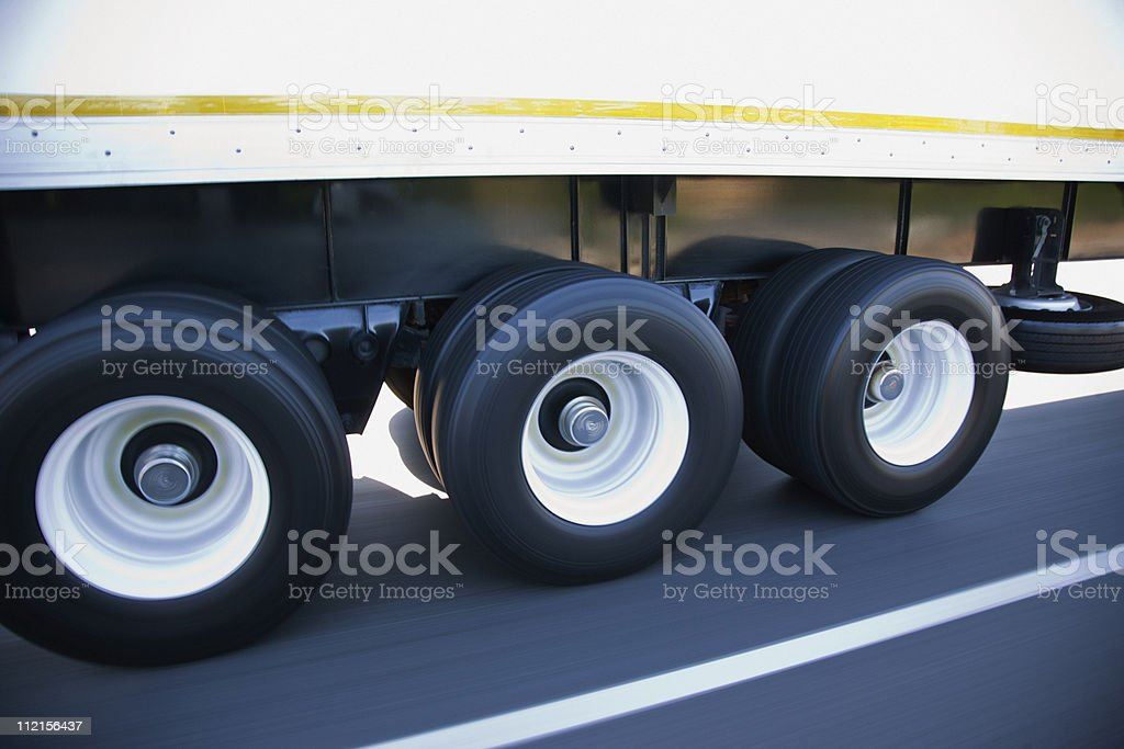 Speeding tires on semi-truck stock photo