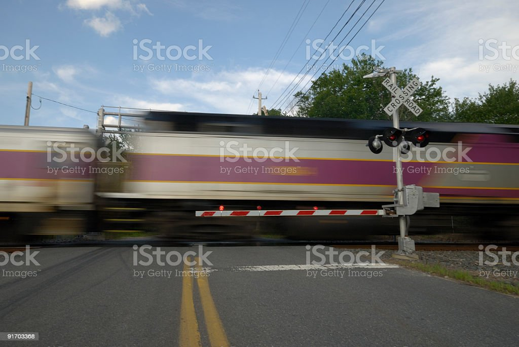 Speeding train crossing a street stock photo