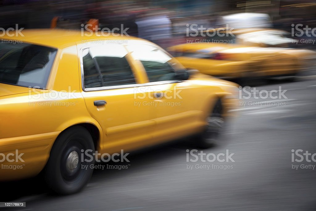 Speeding Yellow Taxi Cabs Motion Blur royalty-free stock photo