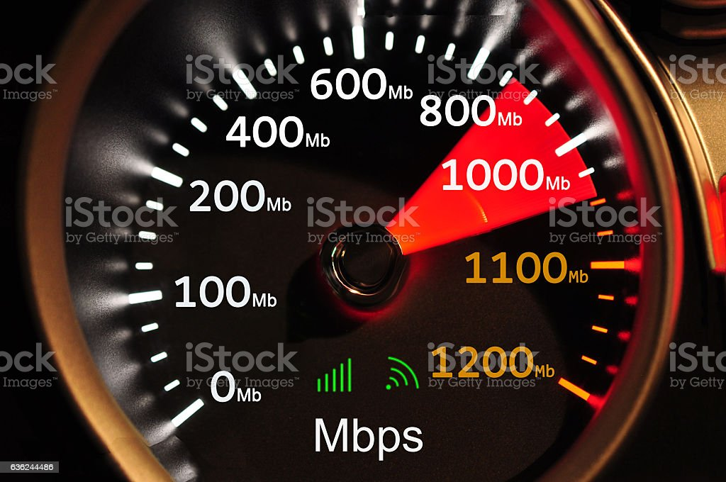 Speedometer and 1000 Mbps high speed internet stock photo
