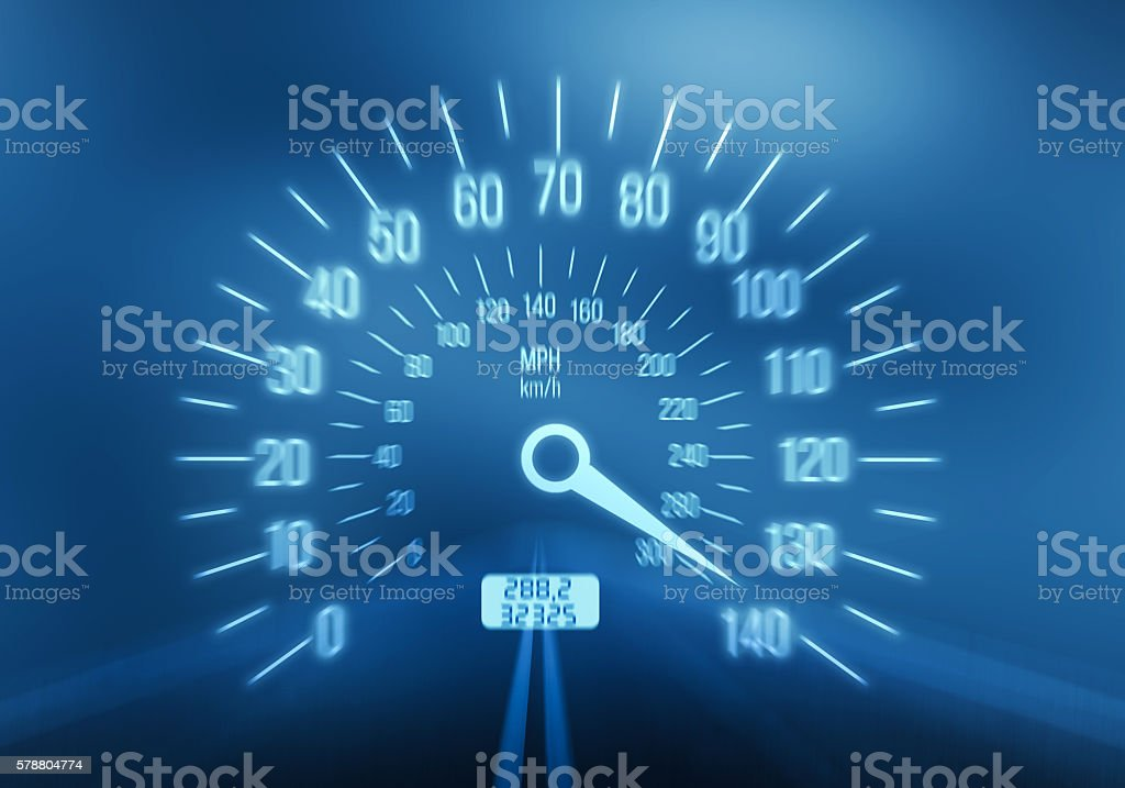 Speedometer on blue background stock photo