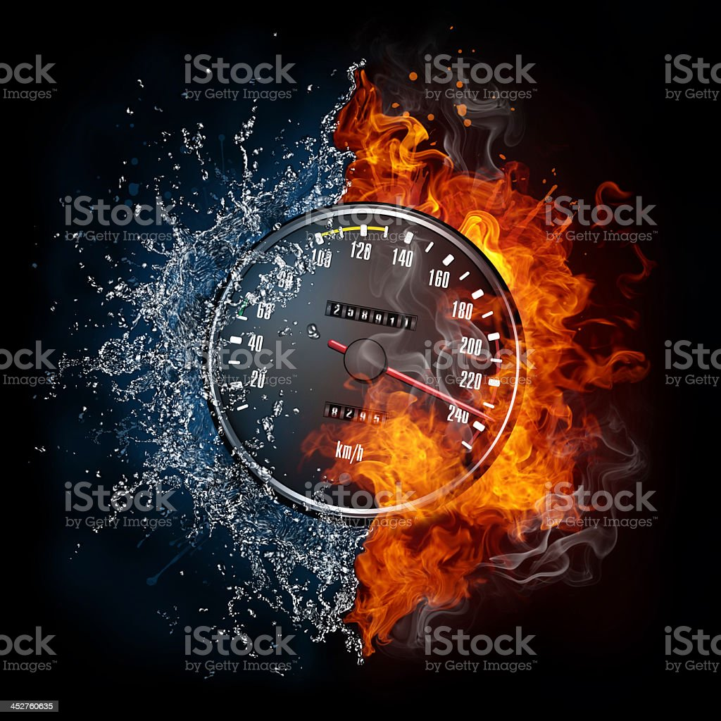 Speedometer surrounded by fire and water on black background stock photo