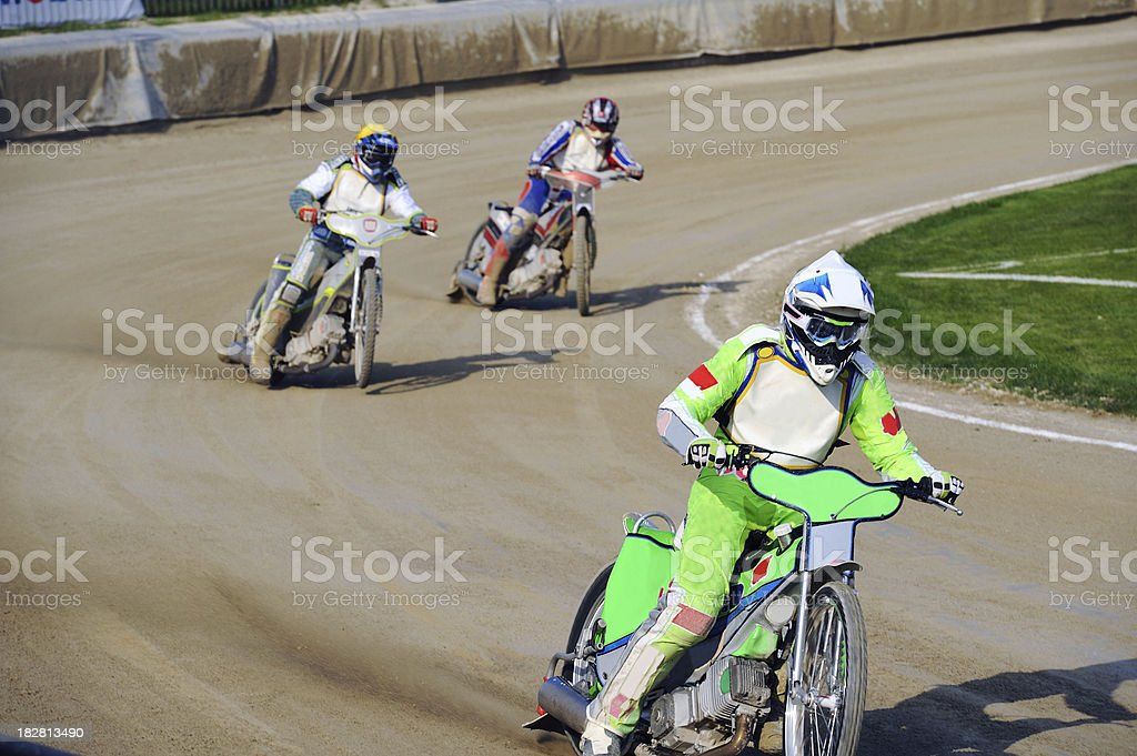 Speedway racers at full speed stock photo