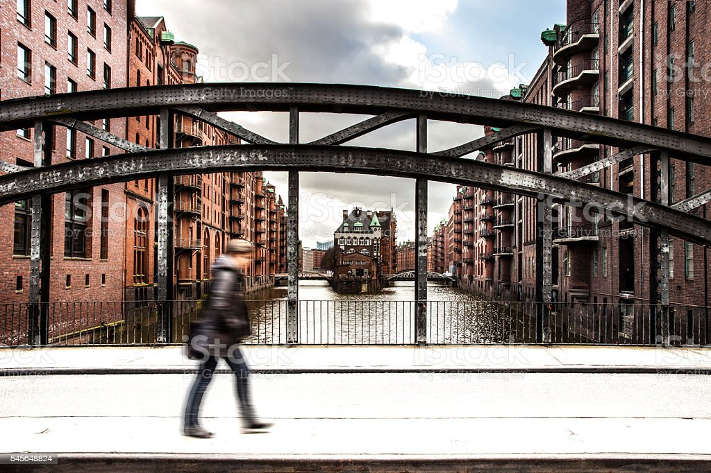 Speicherstadt in Hamburg with a person passing by stock photo