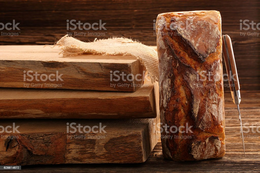Spelled bread on wooden background stock photo