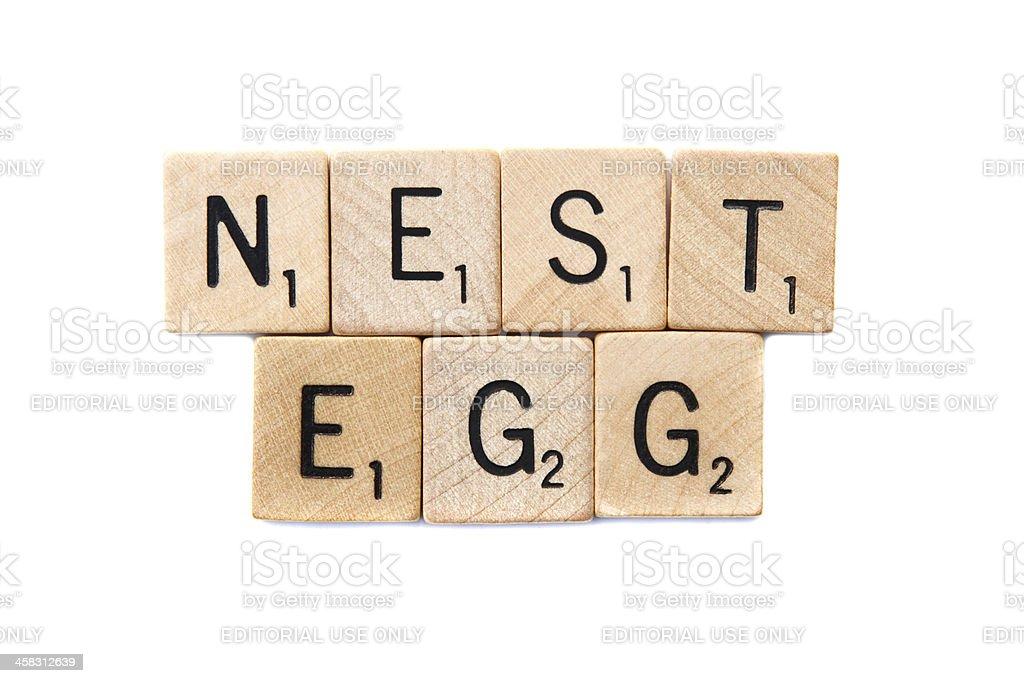 NEST EGG spelled in Scrabble letter tiles royalty-free stock photo