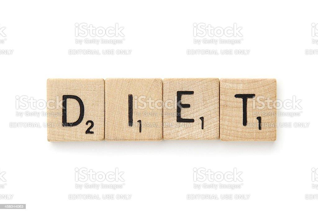 DIET spelled in Scrabble letter tiles royalty-free stock photo