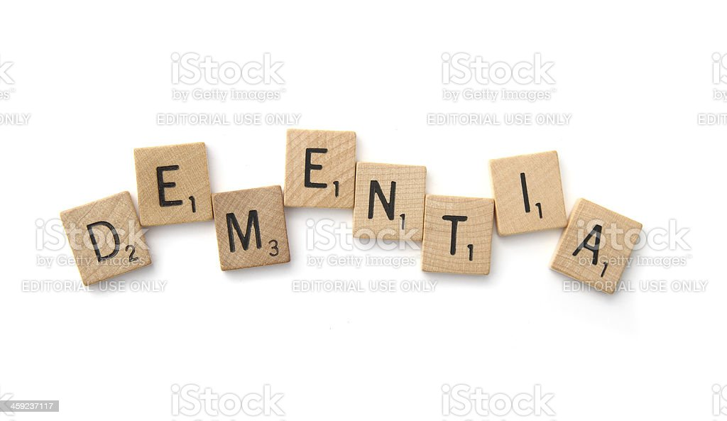 DEMENTIA spelled in Scrabble letter tiles royalty-free stock photo