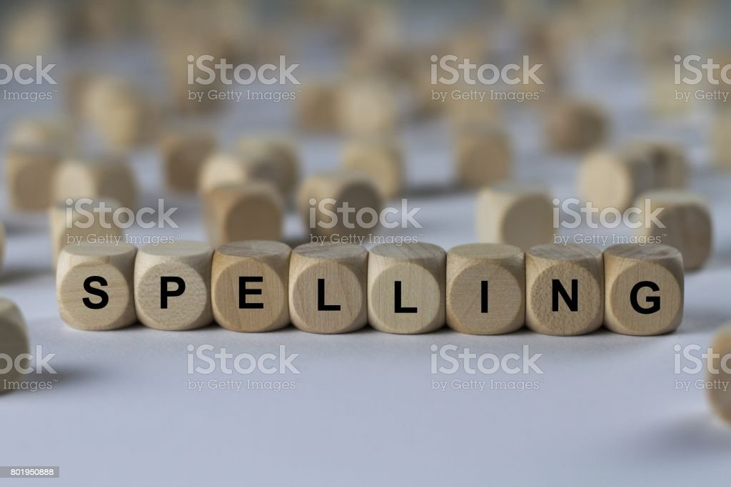 spelling - cube with letters, sign with wooden cubes stock photo