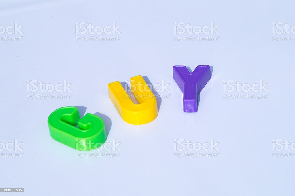 GUY spelling from plastic letters stock photo