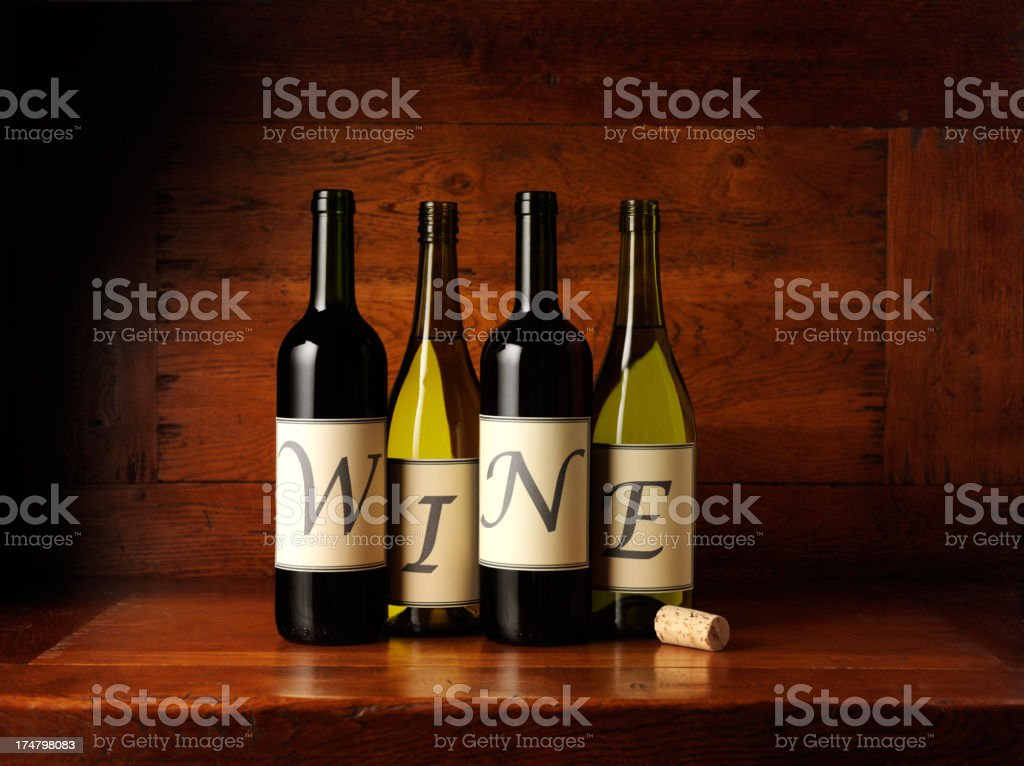 Spelling Wine on Bottles with a Cork royalty-free stock photo
