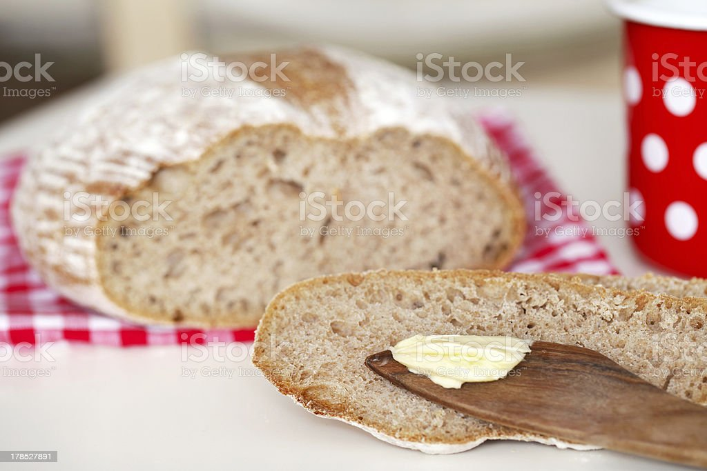 Spelt flour bread slice with butter at breakfast royalty-free stock photo